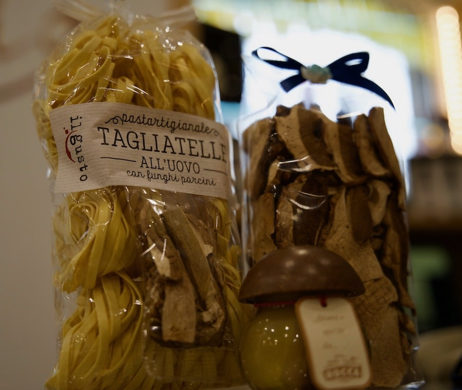 Packets of tagliatelle pasta, dried mushrooms and porcini cream